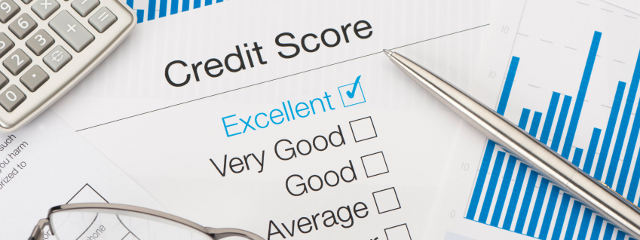 Excellent Credit Score with pen and calculator